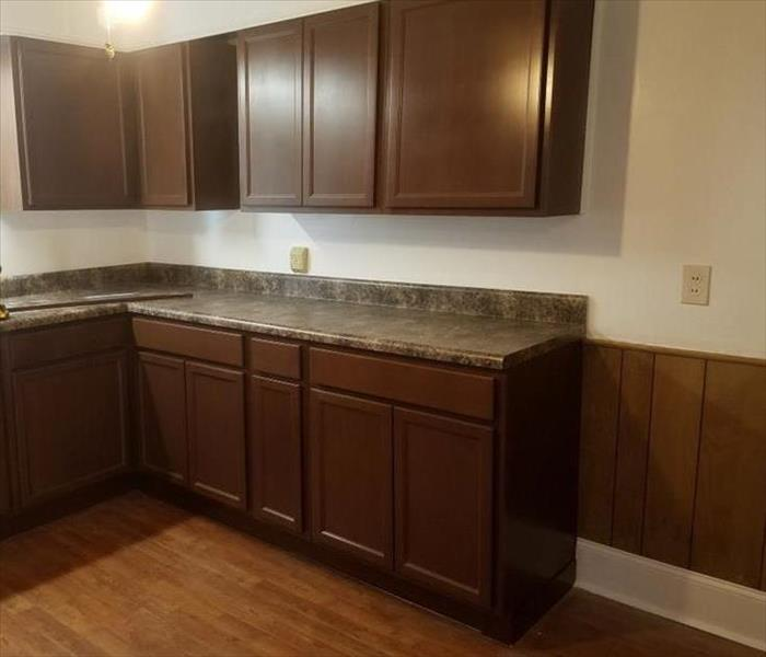 Completed kitchen with granite counter tops and wood cabinets