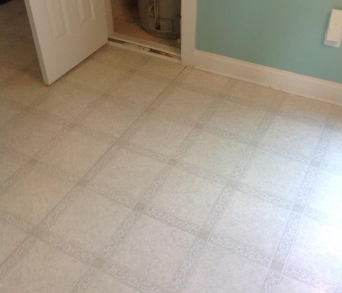 Room with white tile flooring
