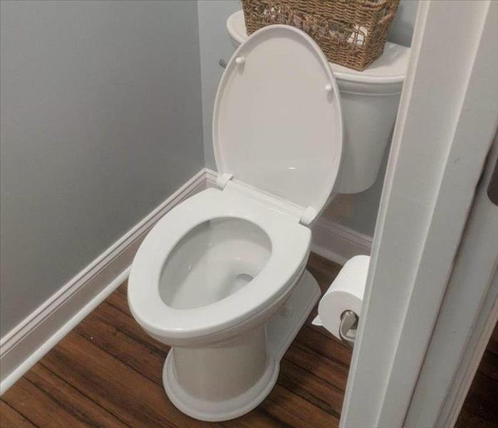 Replaced flooring and toilet