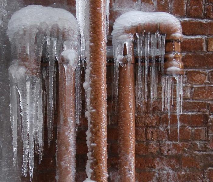 Ice frozen on pipes outside of home