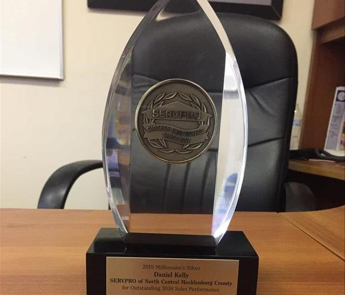 Convention Award sits on owners desk
