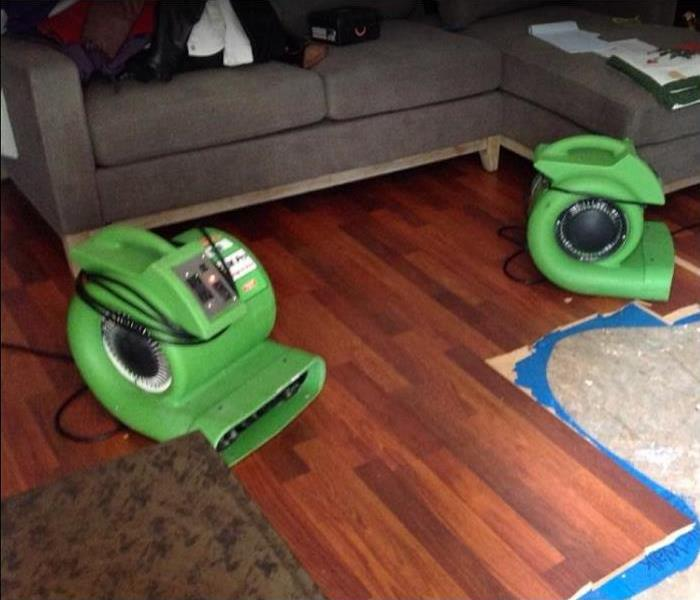 SERVPRO restoration equipment being used on water damaged living room